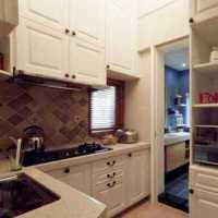 厨房橱柜台面上的绿色小盆栽效果图
